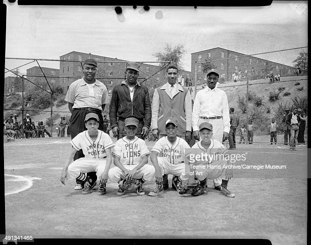 Little League baseball team managers posed on Kennard Field for Uptown Little League opening day Pittsburgh Pennsylvania May 1954 From left Gary...