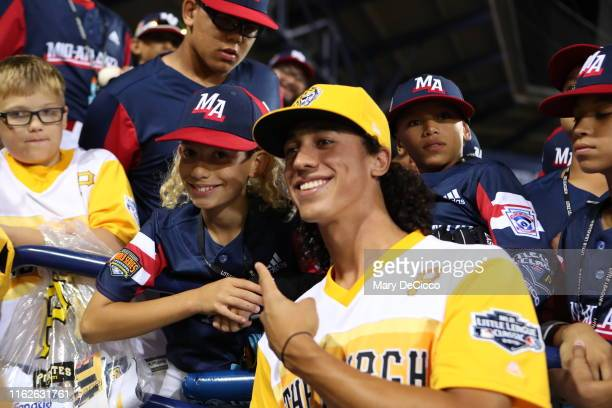 Little League fans pose for a picture with Cole Tucker of the Pittsburgh Pirates after the game against the Chicago Cubs during the 2019 Little...