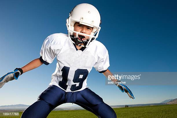 little league football player ready to tackle - tackling stock pictures, royalty-free photos & images