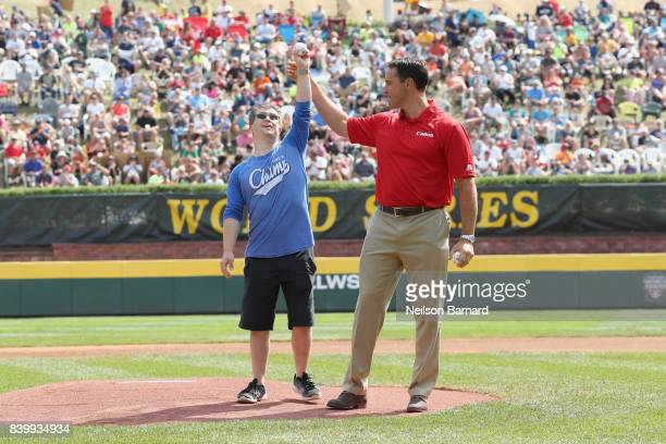 Little League Hall of Excellence honoree Champ Pederson and former New York Yankee Mark Teixeira throw out the first pitch together at the Little...