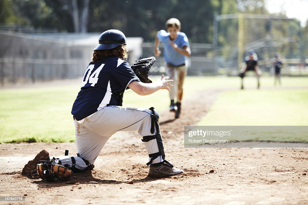 Little league player running to home base. : Stock Photo