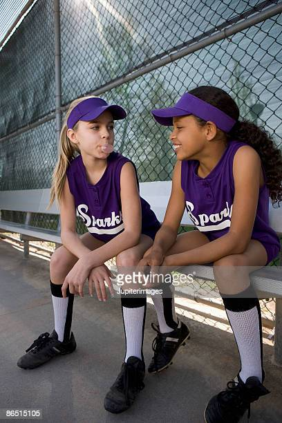 Little league players in dugout