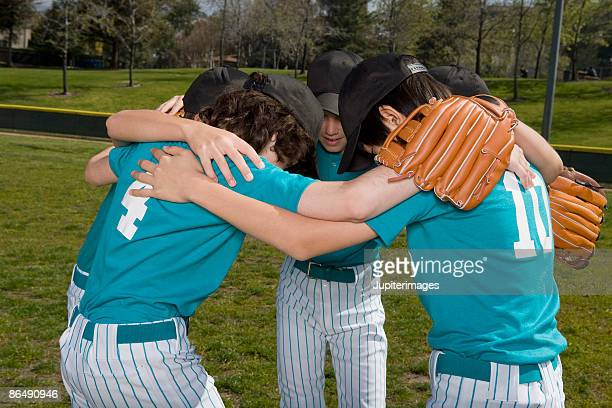 Little league players in huddle