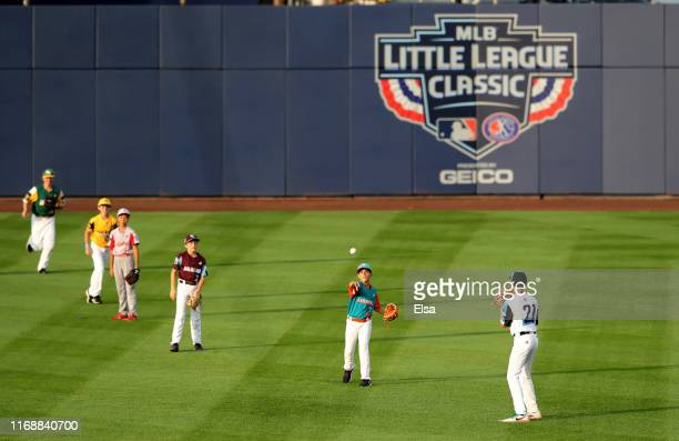 Little League players send in the ball for the ceremonial first pitch before the game between the Pittsburgh Pirates and the Chicago Cubs during the...