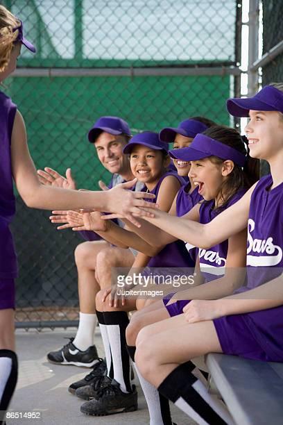 little league team cheering in dugout - dugout fotografías e imágenes de stock