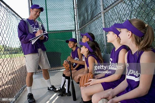 little league team in dugout - dugout fotografías e imágenes de stock