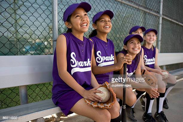 little league team in dugout - softball stock pictures, royalty-free photos & images