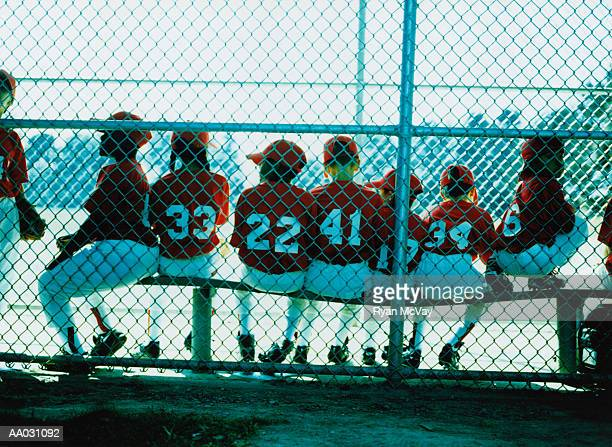 little league team in dugout - baseball team stock pictures, royalty-free photos & images