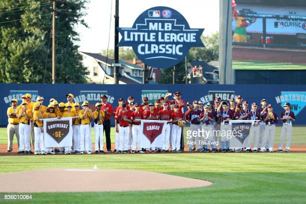 Little League World Series teams line the field during the pregame ceremony prior to the 2017 Little League Classic Game between the St Louis...