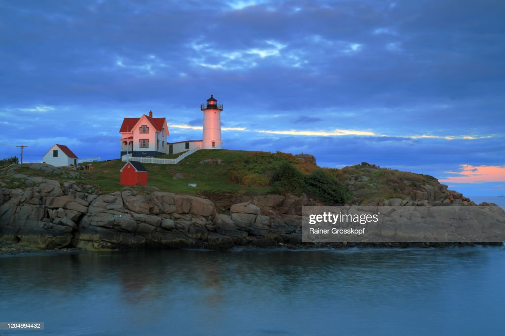 Little lighthouse on a small island at sunset : Stock-Foto