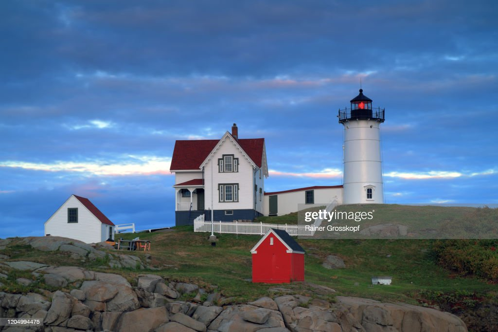 Little lighthouse on a small island at sunset : Stock Photo