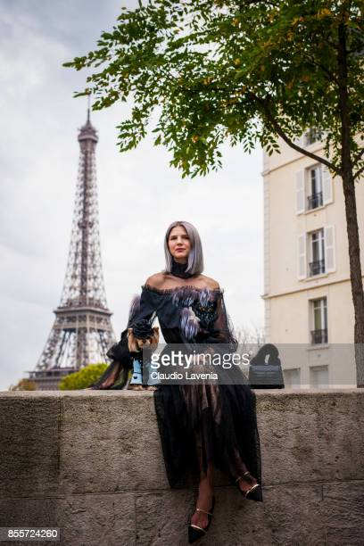 Little Lola Sunshine the dog wears a dress inspired by Andrew GN and Samantha Angelo are seen in front of the Eiffel Tower after the Andrew GN show...