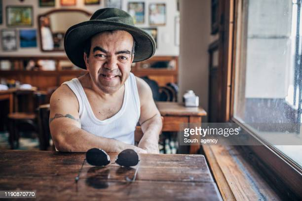 little man in coffee shop - dwarf man stock pictures, royalty-free photos & images