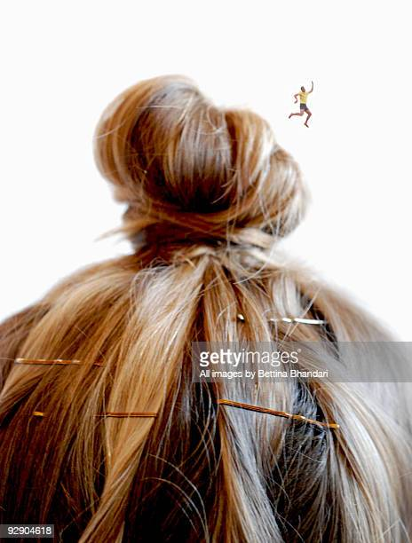 little man jumping from a bundle of hair - topknot stock pictures, royalty-free photos & images