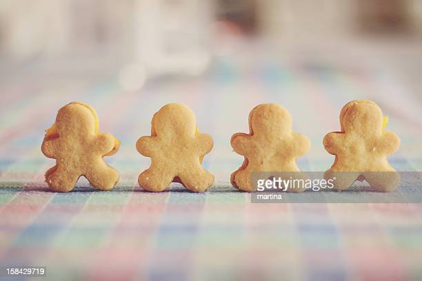 Little man shaped biscuits with lemon custard