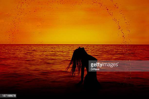 little mermaid 2 - naturalist beach stock photos and pictures