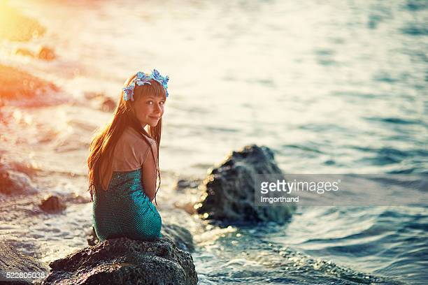 Little mermaid at the shore