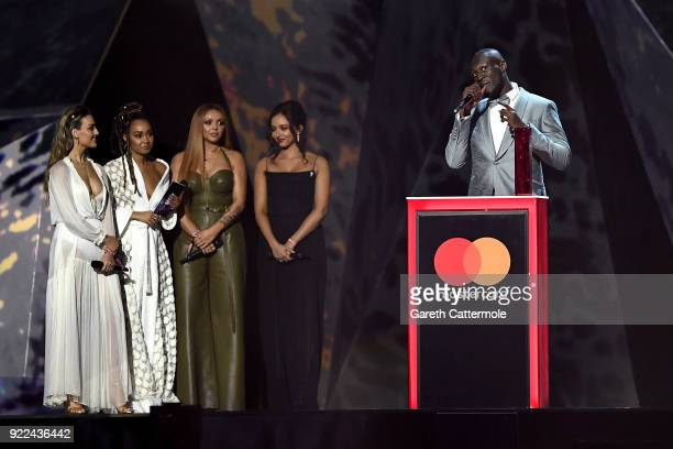 AWARDS 2018 *** Little Mix members present Stormzy with the Best British Male Solo Artist award at The BRIT Awards 2018 held at The O2 Arena on...