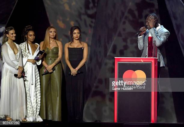 AWARDS 2018 *** Little Mix present Stormzy with the Best British Male Solo Artist award at The BRIT Awards 2018 held at The O2 Arena on February 21...