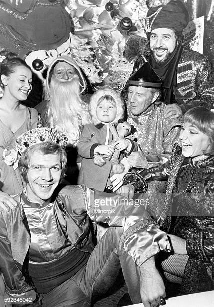Little Morag Kelly meets the cast of Aladdin appearing at the King's Theatre and Santa at Wylie Hill's Store Buchanan Street Glasgow They included...