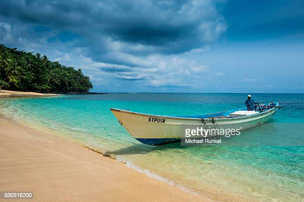 Little motorboat in the turquoise waters of Banana beach, UNESCO Biosphere Reserve, Principe, Sao Tome and Principe, Atlantic Ocean, Africa