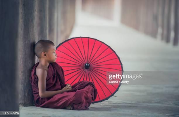 Little Myanmar monk sitting in monastery