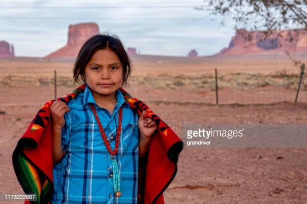 little navajo boy in his yard on the navajo indian reservation in monument valley arizona - cherokee culture stock pictures, royalty-free photos & images