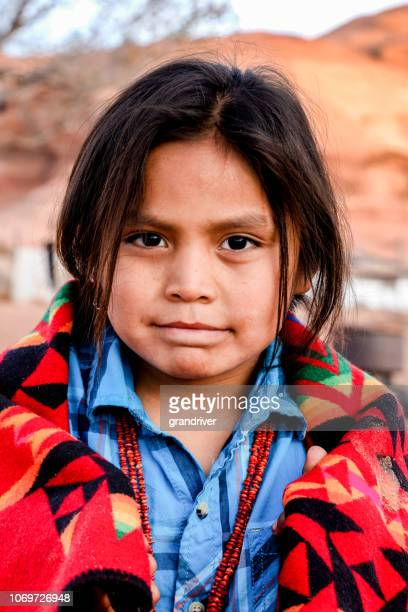 little navajo native american boy with long hair in monument valley, arizona - native american reservation stock pictures, royalty-free photos & images