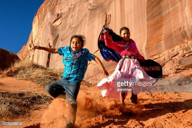 Little Navajo Native American Boy with Long Hair in Monument Valley, Arizona