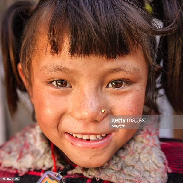 Little Nepali girl in village near Annpurna Range, Nepal