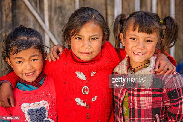 little nepali girls in village near annpurna range, nepal - nepalese ethnicity stock pictures, royalty-free photos & images