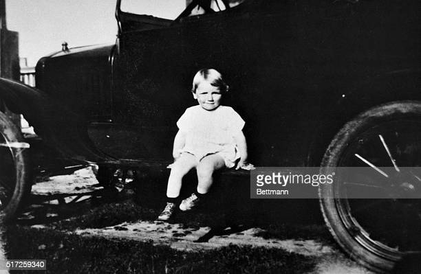 Little Norman Jean Baker is hardly camera shy as she sits on a Model A Ford being photographed Norma Jean in later life Marilyn Monroe found herself...