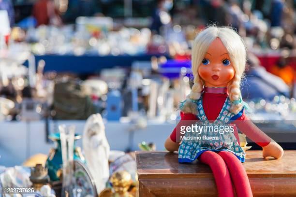 little old doll at the flea market - 人形 ストックフォトと画像