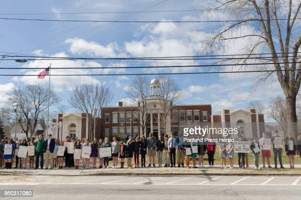 A little over 100 North Yarmouth Academy students from the middle and upper school line Main Street in Yarmouth during a studentorganized silent...