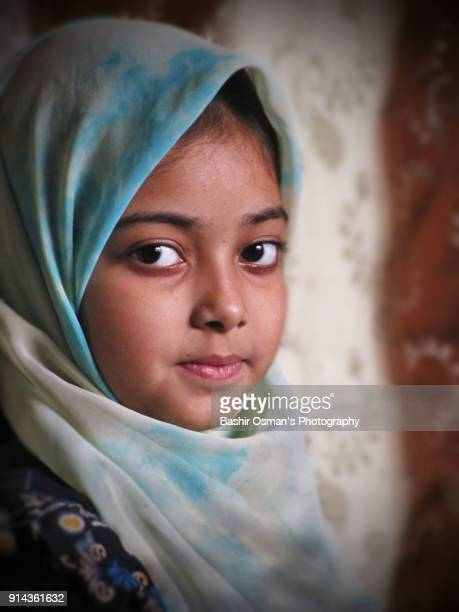 a little pakistani girl wearing hijab - pakistan girl stock photos and pictures
