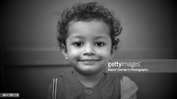 a little pakistani girl with different facial expression - pakistan girl stock photos and pictures
