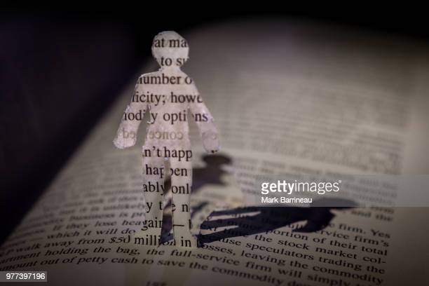 a little paper man - dictionary stock pictures, royalty-free photos & images