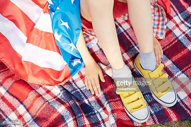 Little patriot on picnic blanket