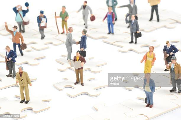 Little people on puzzle pieces figurines