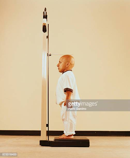 Little Person Measuring His Height