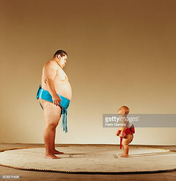Little Person Preparing to Fight Sumo Wrestler