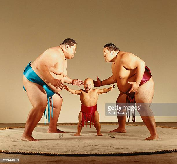 Little Person Refereeing Sumo Match