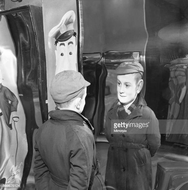Little Peter MacNeil has a laugh at himself in the distorted mirrors at the Louis Tousaud Chamber of Horrors in Brighton Sussex 5th March 1954