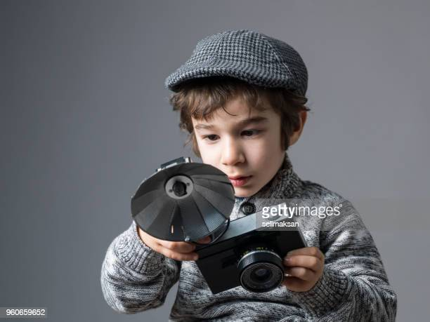 Little Photographer Using Old Fashioned Camera