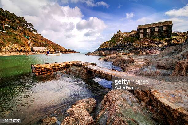 Little pier and the net loft building at Polperro, Cornwall, England