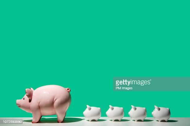 Little piggy banks following big piggy bank