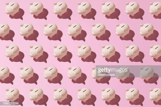 little pink ceramic piggy bank pattern on pink background. concept of saving money, savings. - design stock pictures, royalty-free photos & images