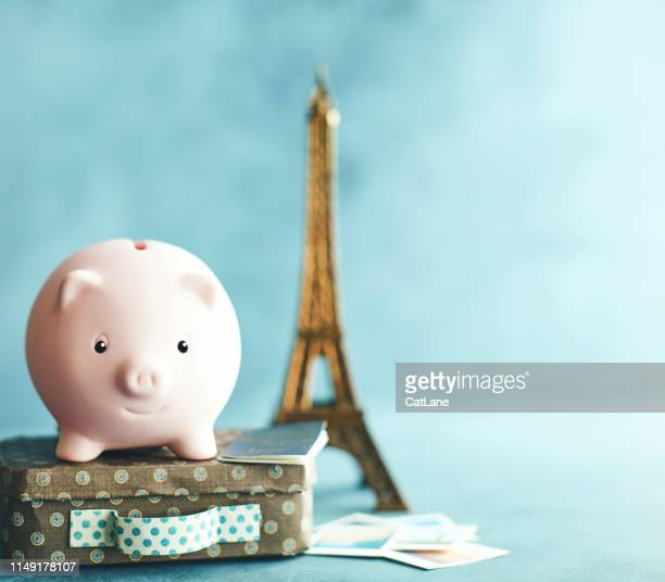 little pink piggy bank on vacation. saving for a trip to france - the hobbit: an unexpected journey stock pictures, royalty-free photos & images