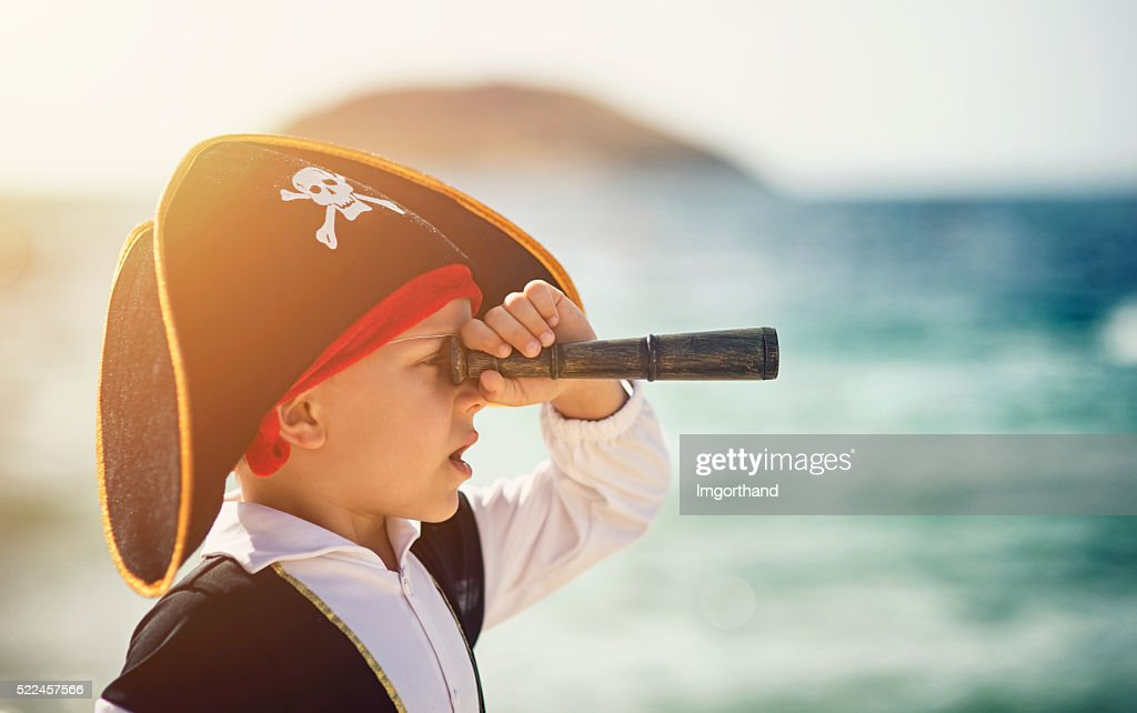 Little pirate looking with spyglass : Stock Photo