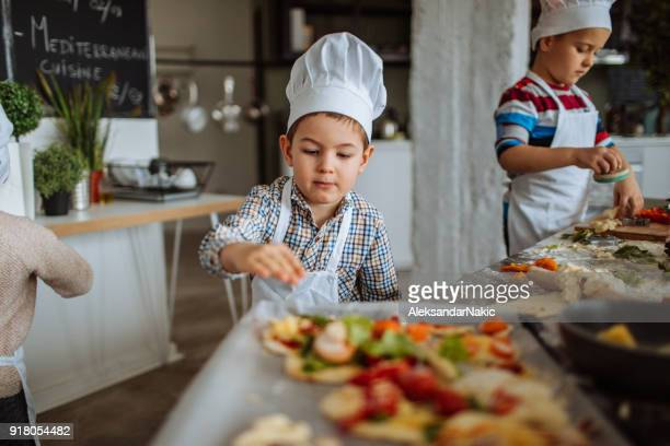 little pizza chefs - chef's hat stock pictures, royalty-free photos & images